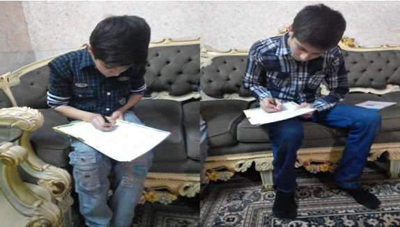 Hassan Mukhtar and Azzan Mukhtar signing the Up For School Petition